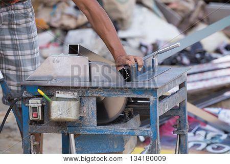 Worker Cutting Aluminium With Grinder Blade