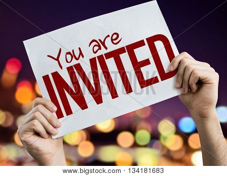 You Are Invited placard with night lights on background