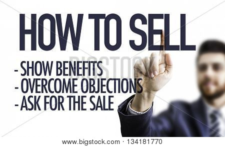 Business man pointing the text: How To Sell