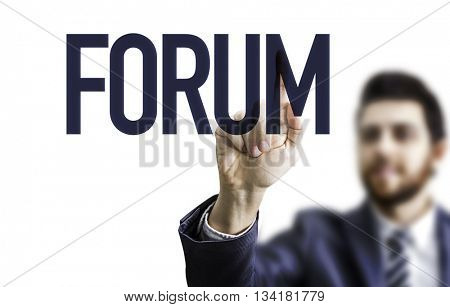 Business man pointing the word: Forum
