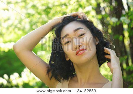 Outdoor portrait of a beautiful young Korean Asian woman