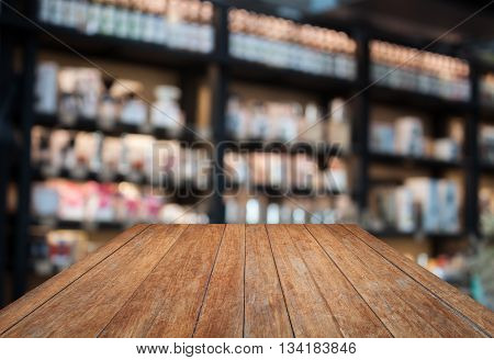 Perspective wooden with coffee shop blurred background with bokeh, stock photo