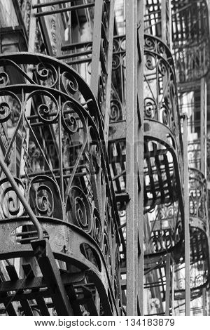 Close-up of some steel balconies with fire escape ladders