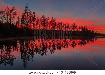 lake with trees and sundown in autumn