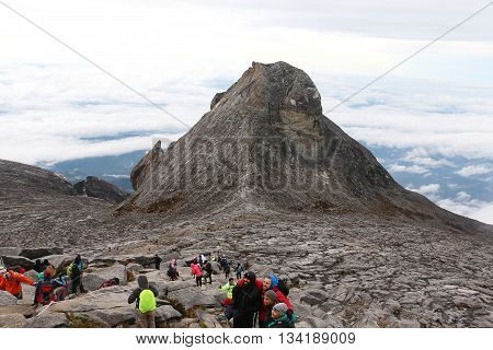 MOUNT KINABALU, SABAH MALAYSIA - JUNE 12, 2016: More than one hundred hikers summited Low's peak of Mount Kinabalu despite the strong wind and thick fogged during the summit push at 3am Malaysia time.