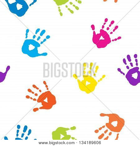 Seamless pattern with a cute colorful handprints