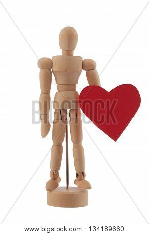 Wooden man toy statue and heart isolated on white background. Valentine's day concept.