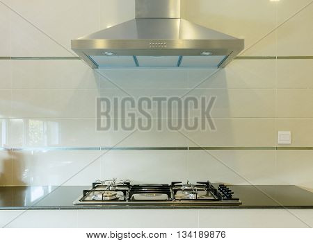 Cooking Gas Stove With Hood In Modern Kitchen