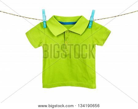 Child t-shirt hanging on the clothesline on white background