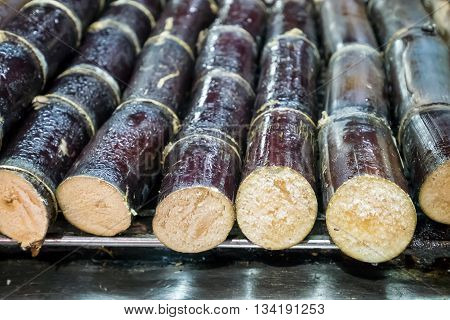 The close up of Taiwanese grilled sugarcane at food street night market in Taipei, Taiwan.