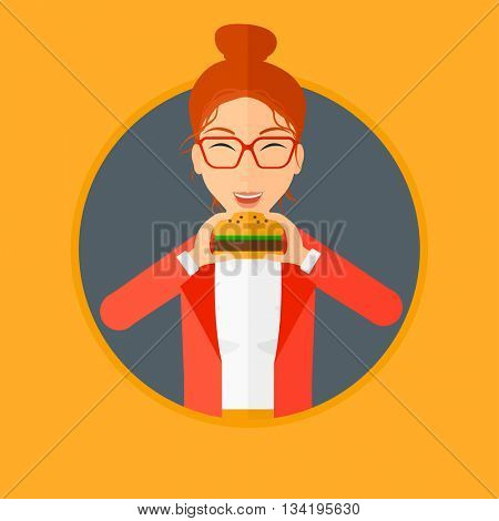 Young woman eating hamburger. Happy woman with eyes closed craving hamburger. Woman is about to eat delicious hamburger. Vector flat design illustration in the circle isolated on background.