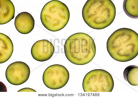 Raw eggplant sliced slices on a white background. Isolated. Food background.