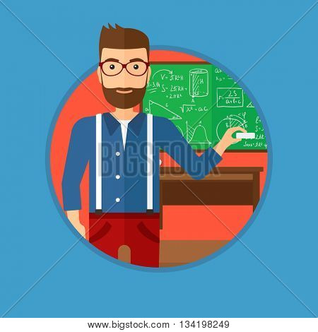 A hipster teacher with the beard standing in classroom. Teacher standing in front of the blackboard with a piece of chalk in hand. Vector flat design illustration in the circle isolated on background.
