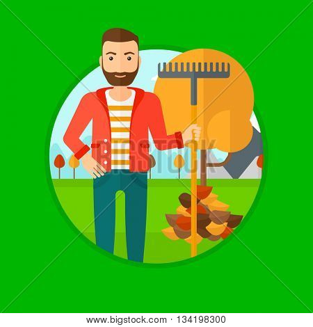 Hipster man raking autumn leaves. Man with rake standing near tree and heap of autumn leaves. Man tidying autumn leaves in garden. Vector flat design illustration in the circle isolated on background.