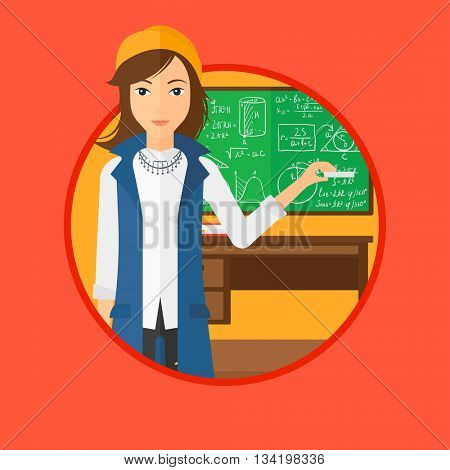 A teacher standing in classroom. Teacher standing in front of the blackboard. Teacher with a piece of chalk in her hand. Vector flat design illustration in the circle isolated on background.