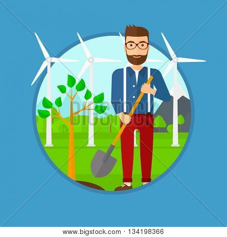 A hipster man plants a tree. Man standing with shovel near newly planted tree. Man planting tree on a background of wind turbines. Vector flat design illustration in the circle isolated on background.
