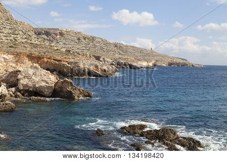 rocky coast of Mediterranean Sea with blue water on Malta Europe