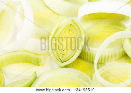 background of sliced leek rings close up.