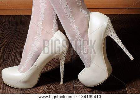 Girl In White Shoes With Rhinestones On The Heels