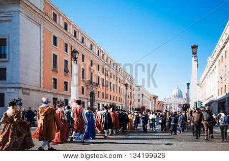VATICAN CITY,VATICAN - January 6, 2015 : Tourists on foot Saint Peter's Square in Vatican on January 6, 2015.is the smallest internationally recognized independent state in the world, Vatican