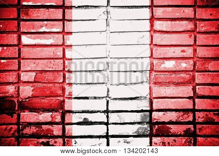 Peru flag on old brick wall texture background
