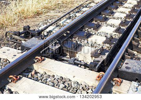 Railway Tracks and Switch near Train Station.