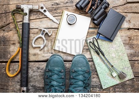 Climbing Tools With Boots On Wood Background