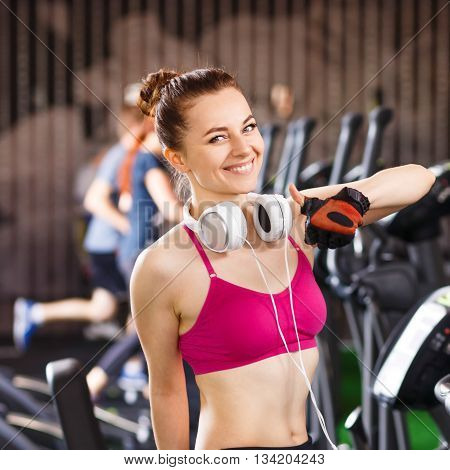 Young Happy Woman At Cardio Area In Fitness Center