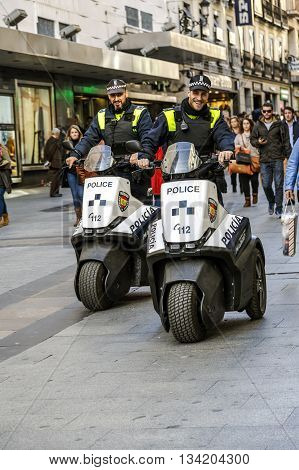 Madrid Spain - November 27 2015: Police patrol Madrid with his new electric motorcycle do not pollute not make noise and are very well received by people.