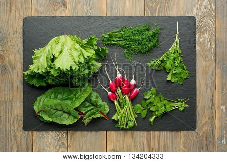 Salad ingredients on stone kitchen board. top view