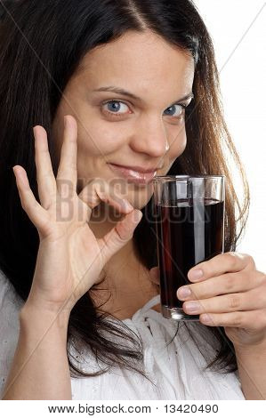 A Young Woman Drinks Some Cold Juice