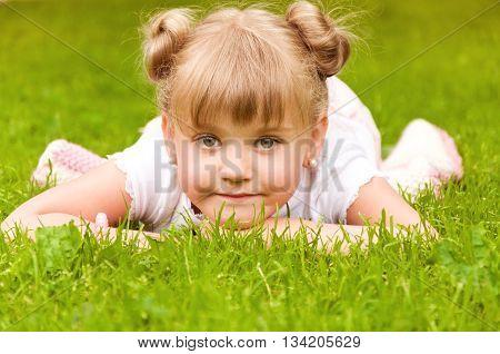 little girl having fun in the park. joy