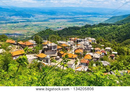 Aerial panorama of high mountain village or selo Delchevo, Bulgaria, Balkans