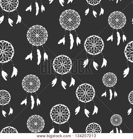 Seamless pattern with freehand dreamcatchers. Ethnic vector illustration on dark background. Black and white wallpaper. Dreamcatchers with feathers