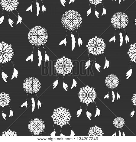 Seamless pattern with freehand dreamcatchers. Tribal vector illustration on dark background. Native american style wallpaper. Dreamcatchers with feathers
