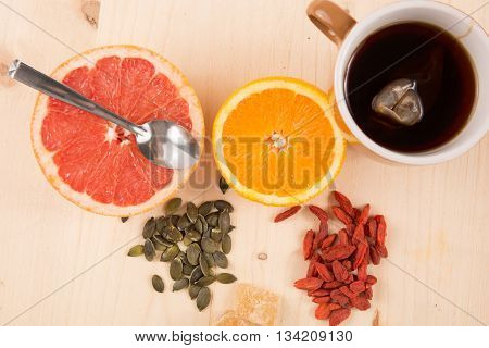 Healthy Breakfast : Tea, Fruits, Madeleine, Goji Berries, Seeds