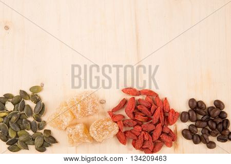 Goji Berries, Seeds, Coffee, Ginger, On Wooden Table With Copy Space