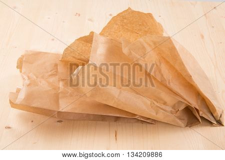 Packaging recycled kraft paper pouch isolated on wooden background with clipping path