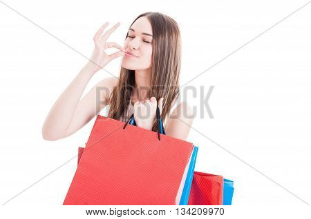Portrait Of Happy Shopaholic Girl Gesturing A Perfect Sign