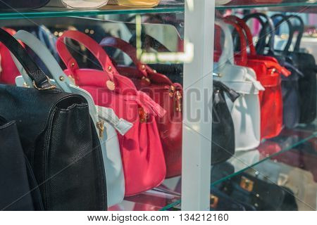 Row of Ladies leather handbags