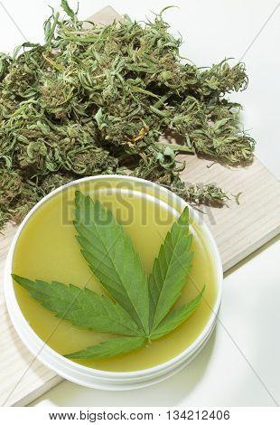 home made ointment and cannabis marijuana green leaf