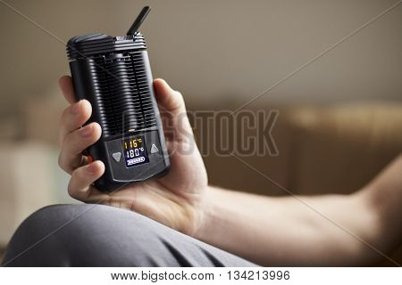 Close Up Of Man Holding Vapourizer