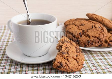 Cup of tea and cookies with chocolate