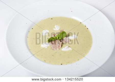 White creamy russian mushrooms soup with croutons