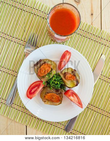 Baked potatoes at home with vegetables and tomato juice. The top view.