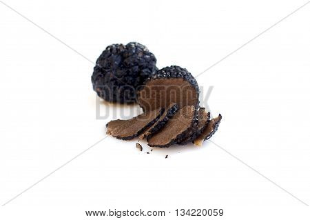 Black truffles isolated gourmet food (shallow depth of field)