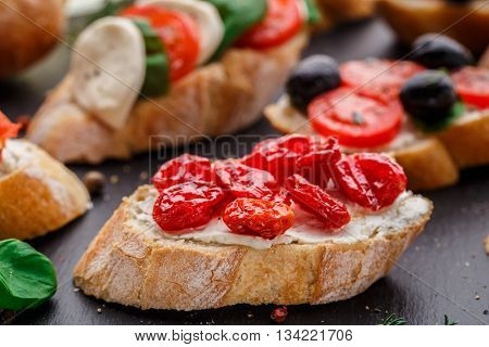 Italian bruschetta with dried cherry tomatoes on crusty ciabatta bread