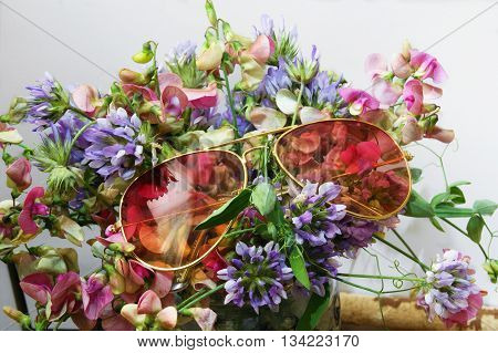 Pink glasses on a bouquet of flowers
