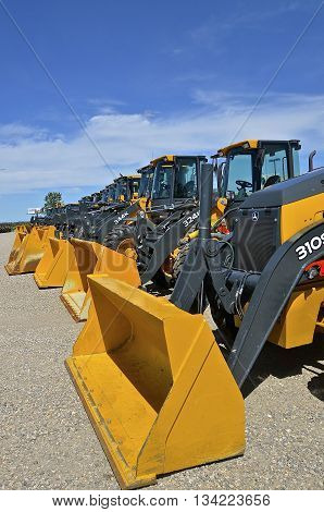 MOORHEAD, MINNESOTA, June 6, 2016: The new backhoe and front end excavator machines  are products of John Deere Co, an American corporation that manufactures agricultural, construction, forestry machinery, diesel engines, and drivetrains.