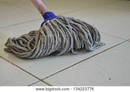mop the tile floor for cleaning in home
